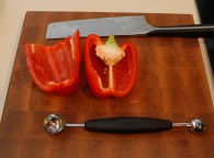 Use a melon baller to remove pepper centers quickly